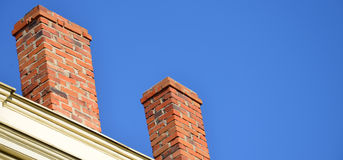 Two brick chimneys Royalty Free Stock Image