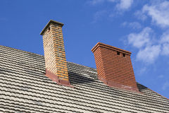 Two brick chimneys Stock Images