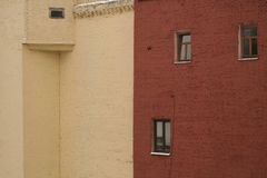 Two brick houses - beige and terracotta stock photography