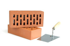 Two bricks and trowel Royalty Free Stock Image