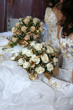 Two brides holding wedding bouquet in hands Stock Images