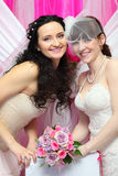 Two brides wearing white dresses hold bouquet Royalty Free Stock Photos