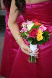 Two Bridesmaids. Holding their bouquets at their backs Stock Image