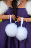 Two bridesmaids in purple holding white feather pom poms Stock Photo
