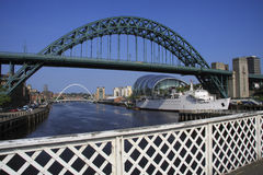 Two Bridges & a Boat. The Tyne and Millennium bridges, with the curved and shiny roof of the Sage Centre to the right. Taken from the Swing bridge, as can be Stock Photo
