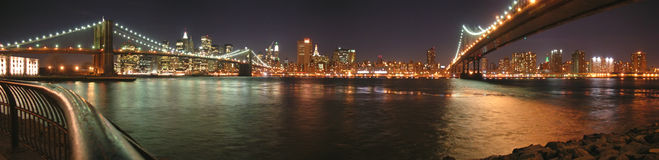 Two bridges with Brooklyn. One by night - New York - Panorama Stock Photos