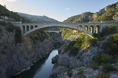 Two bridges gorge on the Hérault River. Two bridges in close proximity to the The Pont du Diable on the Hérault River is one of many bridges in France with Stock Images