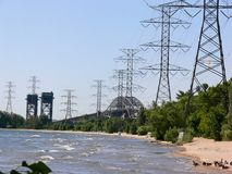 Two bridges and hydro tower. A lift bridge and a highway bridge with power lines on the shore of Stock Photo
