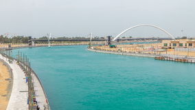 Two bridges over newly opened Dubai canal with a boat crossing under them timelapse. stock video footage