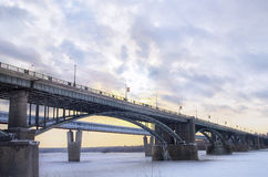 Two bridges. Over the river covered with ice Royalty Free Stock Image