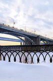 Two bridges. Over the river covered with ice Stock Photo