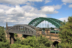 Two Bridges over the Wear. Two of the three of Sunderland's Bridges that cross the River Wear. The grey one on the left is used by trains and Metros. Wearmouth Royalty Free Stock Photography