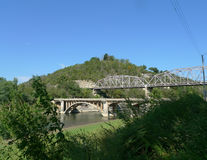 Two bridges in the Ozark Mountains. Metal and stone bridges side by side over Swan Creek where it meets Lake Taneycomo  in Missouri in the Ozark mountains Stock Images