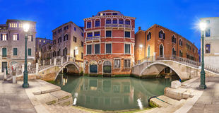 Two bridges and red mansion in the evening, Venice. Italy royalty free stock photography