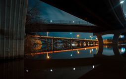Two Bridges reflecting in a lake at night wirh Bright vibrant reflections and light trails. Two Bridges reflecting in a lake at night with Bright vibrant royalty free stock photos