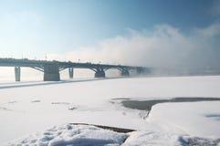 Two bridges through the river. Vanish in fog Stock Photo