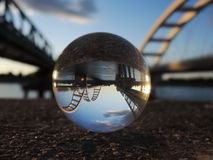 Two bridges on the river Danube reflection in crystal ball. Two bridges on the river Danube in Novi Sad, Serbia reflection in crystal ball stock photo