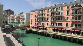 Venice Doha Qatar. Two bridges in Venice Doha at Qanat Quartier in the Pearl, Persian Gulf, Middle East in a sunny day. Aerial view picturesque and luxurious stock footage