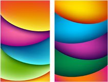 Two bright abstract colorful backgrounds. Set of two bright abstract colorful backgrounds with wavy pattern. Vector paper illustration Stock Photos