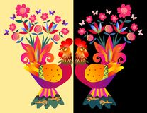 Two bright colorful cockerels - Vases with flowers. Royalty Free Stock Photography