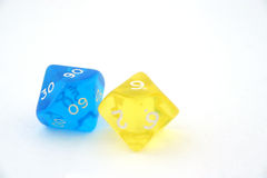 Two bright dices. Closeup of yellow and blue dices Stock Photo
