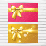 Two bright gift cards. Two vector bright gift card templates, girly pink and gold color cards with shiny golden bow and Royalty Free Stock Photos