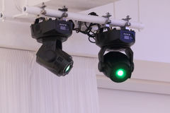 Two bright illuminators devices rays of green light Royalty Free Stock Photography