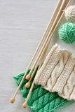 Two bright patterns, yarn balls and needles for knitting Royalty Free Stock Photos