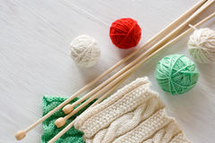 Two bright patterns, yarn balls and needles for knitting Stock Images