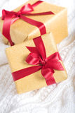 Two  bright presents on knitting background Stock Photo