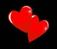 Two bright red hearts on a black background Royalty Free Stock Photo