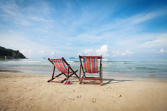 Two bright sun loungers on the beach. Royalty Free Stock Image