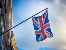 Two British flag flying on the balcony of a building royalty free stock image