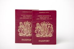 Two British passports. British passports isolated on a white background Royalty Free Stock Images