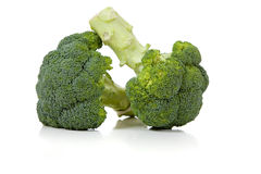 Two broccoli florets on white Stock Image