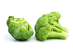 Two broccoli pieces. Isolated on the white background Stock Photos