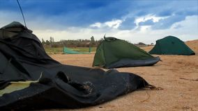Broken tents at the beach stock footage