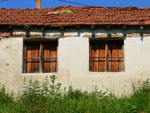 Two broken windows of ruined cottage Royalty Free Stock Images