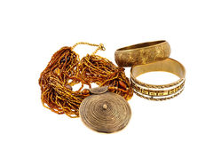 Two bronze bracelets and a necklace Royalty Free Stock Photography