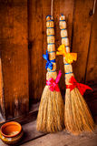 Two brooms with a bow tie and butterflies on a background Royalty Free Stock Photo