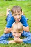 Two bros on grass Royalty Free Stock Photo