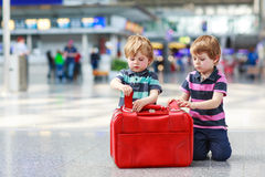 Two brother boys going on vacations trip at airport Royalty Free Stock Photography