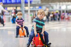 Two brother boys going on vacations trip at airport Royalty Free Stock Image