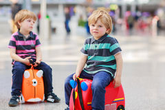 Two brother boys going on vacations trip at airport Stock Photos