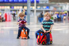 Two brother boys going on vacations trip at airport Stock Images
