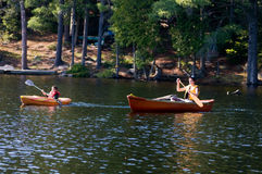 Two brother out paddling on the lake Royalty Free Stock Photography