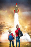 Two brother`s play in astronauts.Look at the rocket launch. dream to go to space. Look at the rocket launch. dream to go to space royalty free stock images