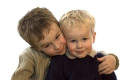 Two Brothers 1. Two lovely brothers, 5 and 2 years of age. On white background stock photography