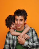 Little Child Hugging His Brother Stock Photo