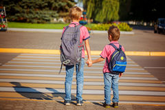 Two brothers  with backpack walking, holding on warm day  on the Stock Photography